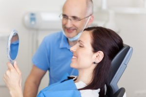 Dentist talks to an implant patient