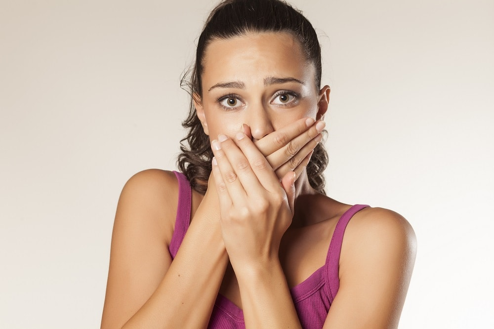 A female patient is shocked about her poor oral health